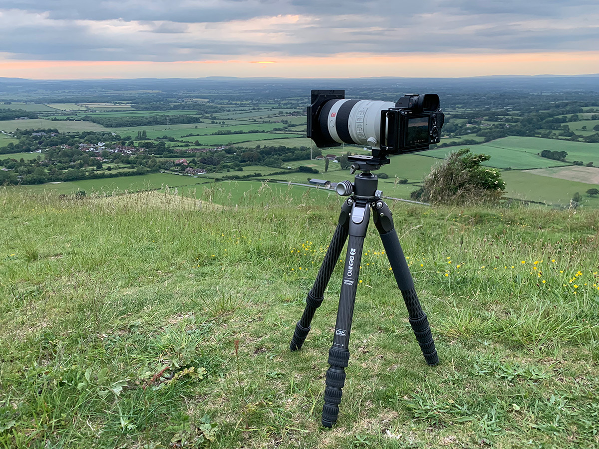 Using the tripod in the field on a windy sunset